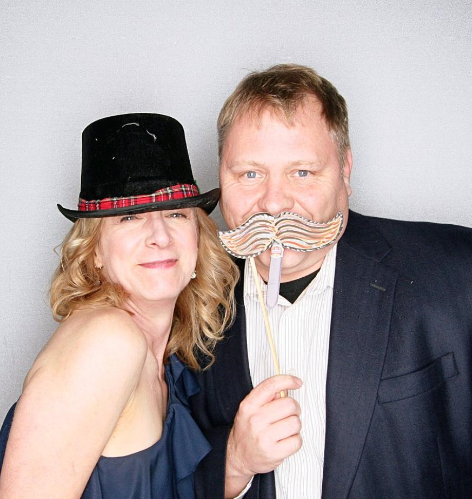 Patrick with his wife at the Holiday Party